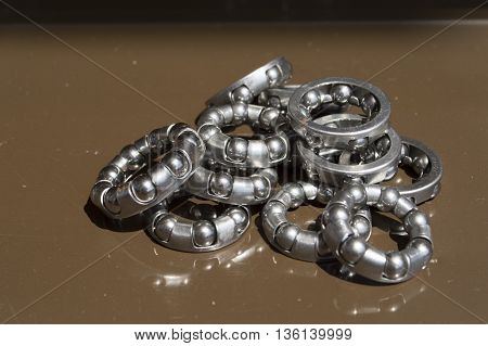 metal bearings for bicycles mechanisms on a brown background