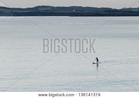 Man practicing surf paddel in the Sardinero beach (Santander España)