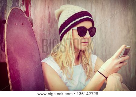 Skater girl with mobile device