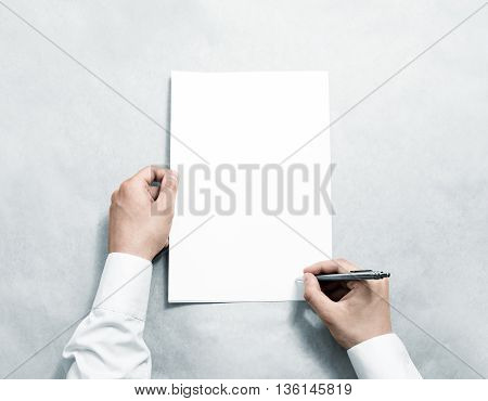 Hand holding blank agreement mockup and signing it. Arm in shirt hold clear document template mock up. Contract surface design. Simple pure legal paper print display. Reading contract statement.