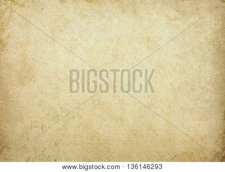 Aging stained paper background. Natural old paper texture for the design.