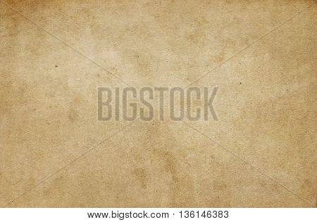 Aged stained paper background. Natural old paper texture for the design.