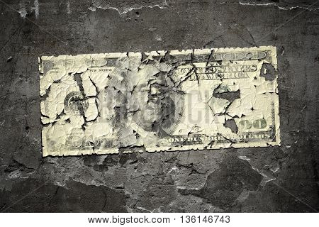 An image of a grunge wall with a worn 100 dollar note
