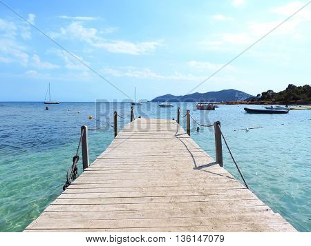 Wooden Gangplank or boardwalk into the sea. Pier or jetty.