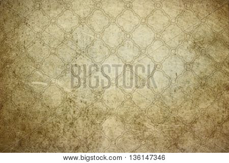 Old dirty paper background with vintage ornament.