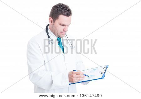 Male Doctor Or Medic Analyzing Charts On Clipboard