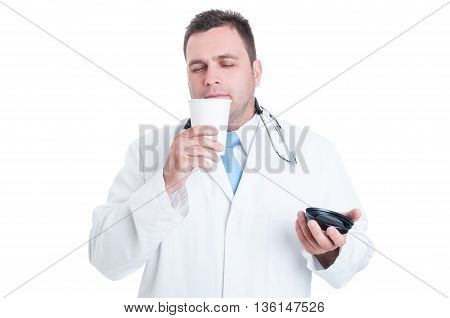 Male Doctor Or Medic Smelling Fresh Coffee From Takeaway Cup