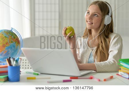 cute teenager girl using computer with apple
