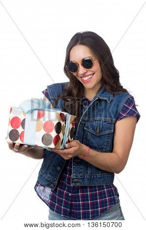 young beautiful girl holding gift isolated on white background