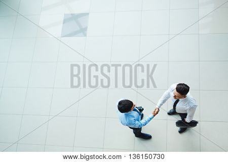 High angle view of businessmen shaking hands