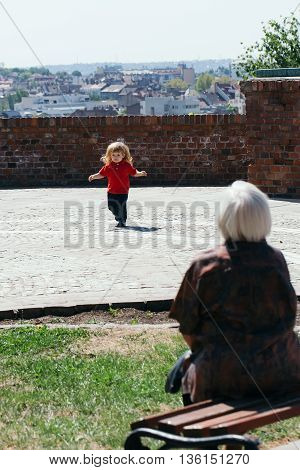 Baby boy on the walk with his grandmother