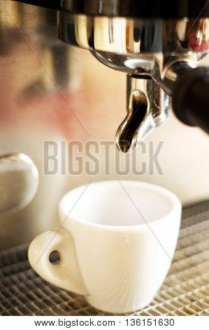 Close-up of espresso from coffee machine. Professional coffee brewing. Barista
