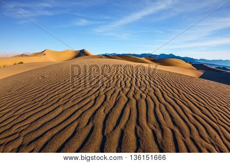 Magnificent sandy waves on dunes. Early morning, sunrise in Death Valley, California