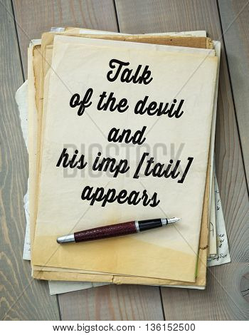 Traditional English proverb.  Talk of the devil and his imp [tail] appears