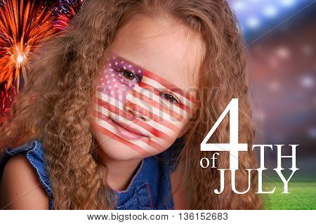Curly little blond girl beauty portrait smiling with american flag on face