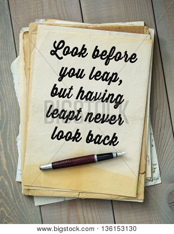 Traditional English proverb.  Look before you leap, but having leapt never look back