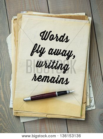 Traditional English proverb.  Words fly away, writing remains