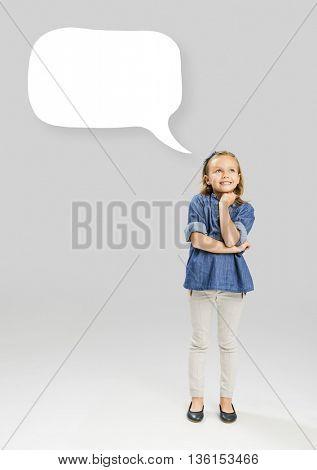 Beautiful little girl holding and showing a speech balloon