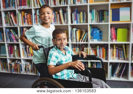 Boy pushing the wheelchair in the library