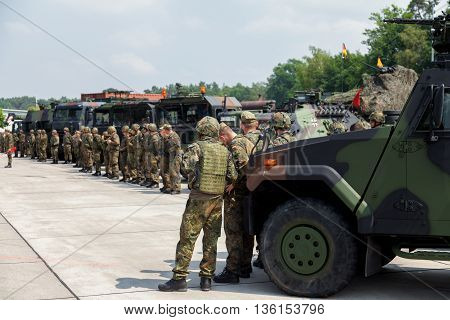 BURG / GERMANY - JUNE 25 2016: german soldiers stands on army convoy at open day in barrack burg / germany on june 25 2016
