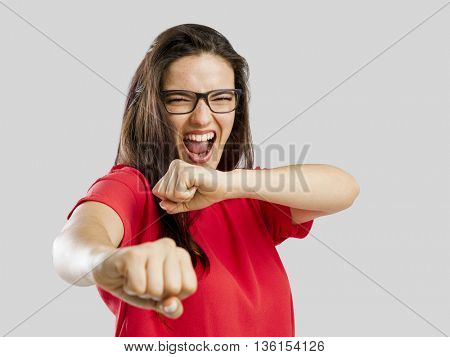 Lovely woman pretending that she's fighting