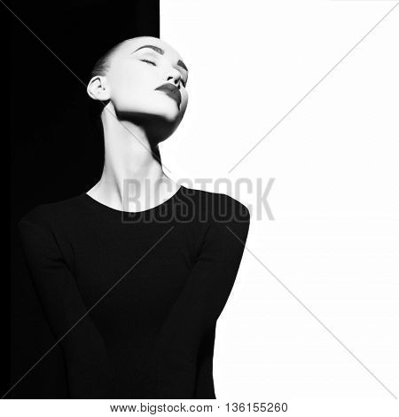 Fashion art studio portrait of elegant blode in geometric black and white background