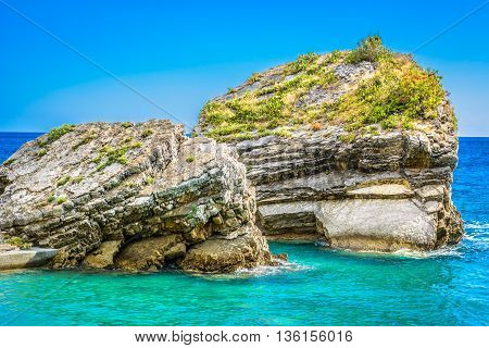 Coastline details with interesting shapes of rocks in Saint Nicholas Island in Budva Montenegro.