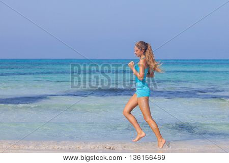 woman exercising on beach seashore in summer.