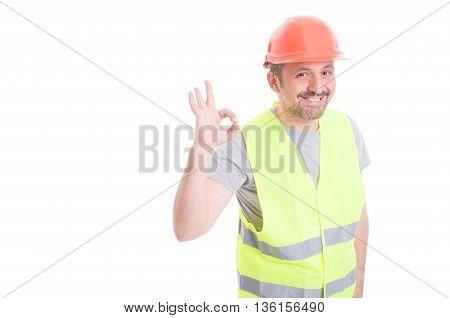 Joyful Builder Wearing Vest And Helmet Showing Ok