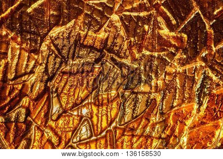 molten glass golden color background texture. fusing