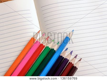 Blank notebook with color pencil. Education concept