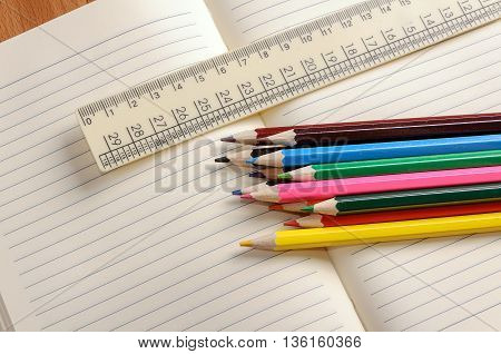 Crayons a ruler and Notepad closeup. School supplies