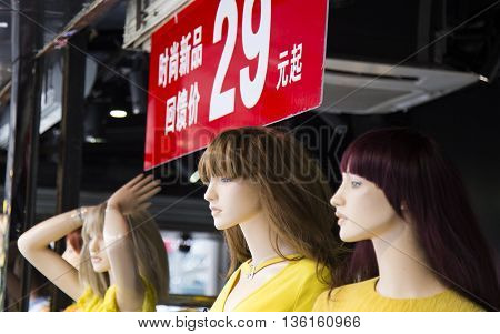 Outdoor dummy, mannequin at a shop in a street of Guangzhou city, Guangdong province, China.