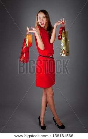 Shopping Woman Holding Bags On Gray Studio Background