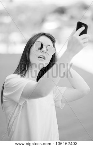 Active And Attractive Young Womantaking A Selfie Photo Of Herself