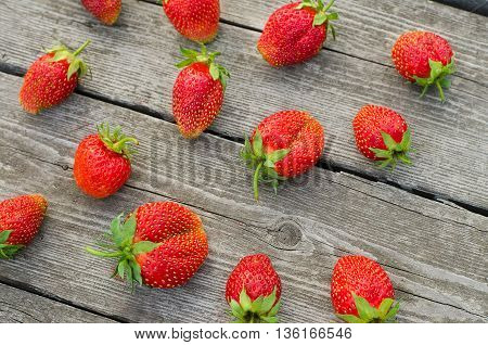 Summer Berries Topic: Ripe Red Strawberries Bunch Of Lies On Gray Wooden Table In The Garden, View F