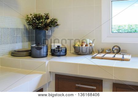 modern pantry with utensil and vase in kitchen