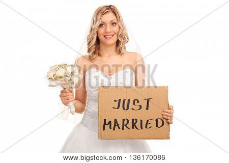 Joyful bride holding a wedding flower and a banner that says just married isolated on white background