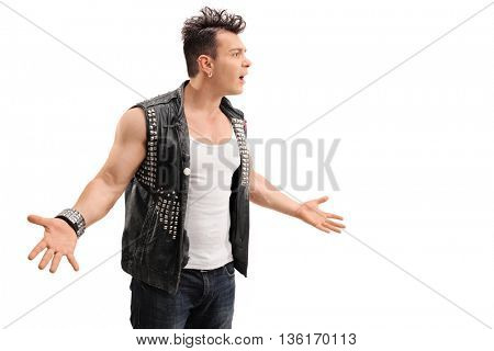 Young male punk rocker arguing with someone isolated on white background