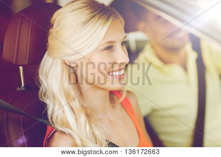 transport, leisure, road trip and people concept - happy man and woman driving car