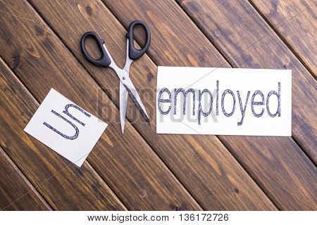 cut paper with word unemployed