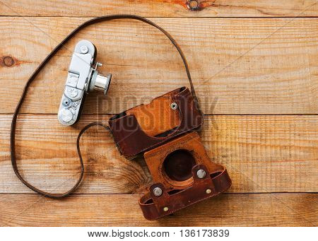 Very Old Film Camera On Brown Wooden Background
