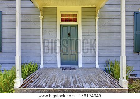Open Entrance Porch With Columns And Blue Door Of An Old House In Lakewood, Wa. Usa