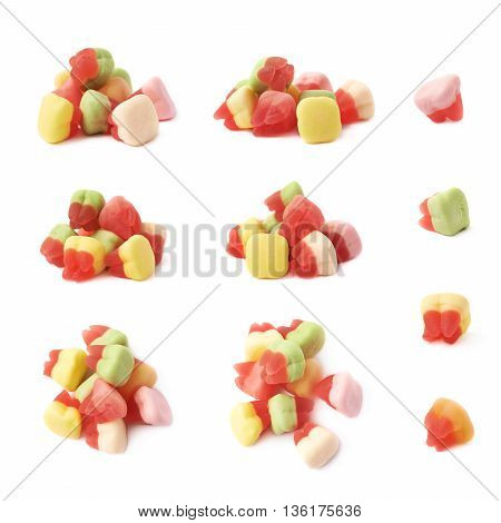Pile of tooth shaped chewing candy isolated over the white background, set of multiple different foreshortenings