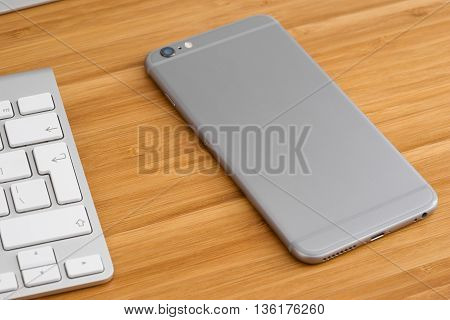 The phone is on the table the rear panel up