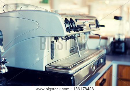 equipment, object and technology concept - close up of coffee machine at bar or restaurant kitchen