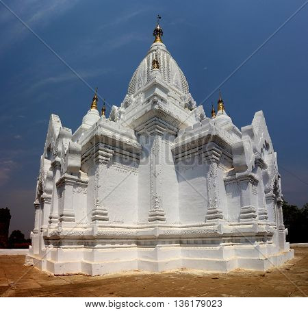 White Pagoda with golden pinnacles in Bagan, Myanmar