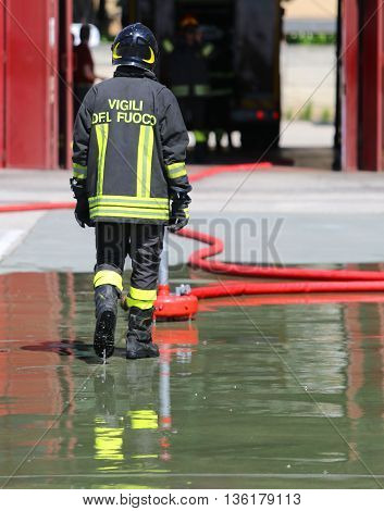 Italian Fireman With Protective Uniform And Helmet On His Head