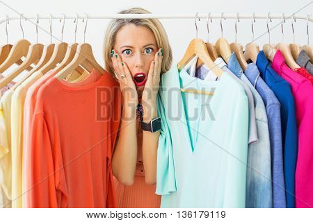 Stressed woman with nothing to wear showing her emotion