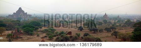 Amazing misty sunrise colors and silhouette of ancient Pagodas, Bagan, Myanmar